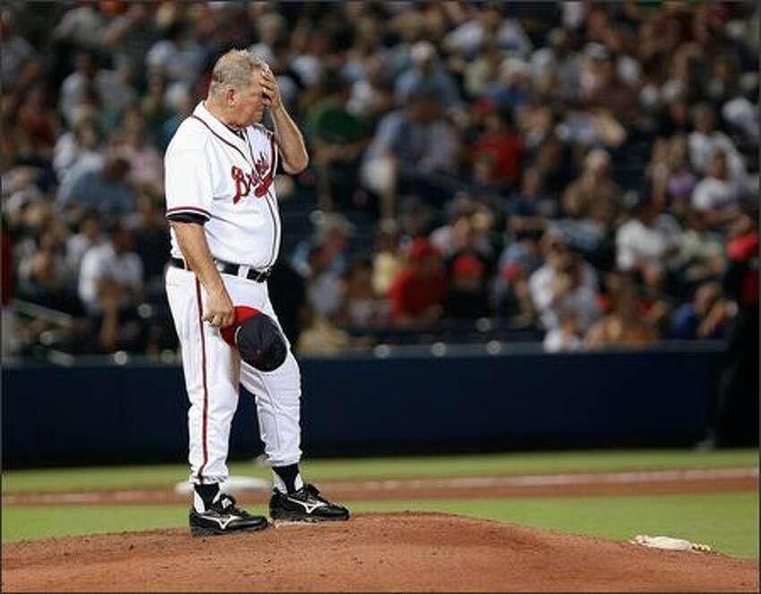 Manager Bobby Cox #6 of the Atlanta Braves stands on the mound and wipes his face while waiting for relief pitcher Manny Acosta #46 to enter the game against the San Francisco Giants on August 16, 2007 at Turner Field in Atlanta, Georgia. Photo by Mike Zarrilli/Getty Images