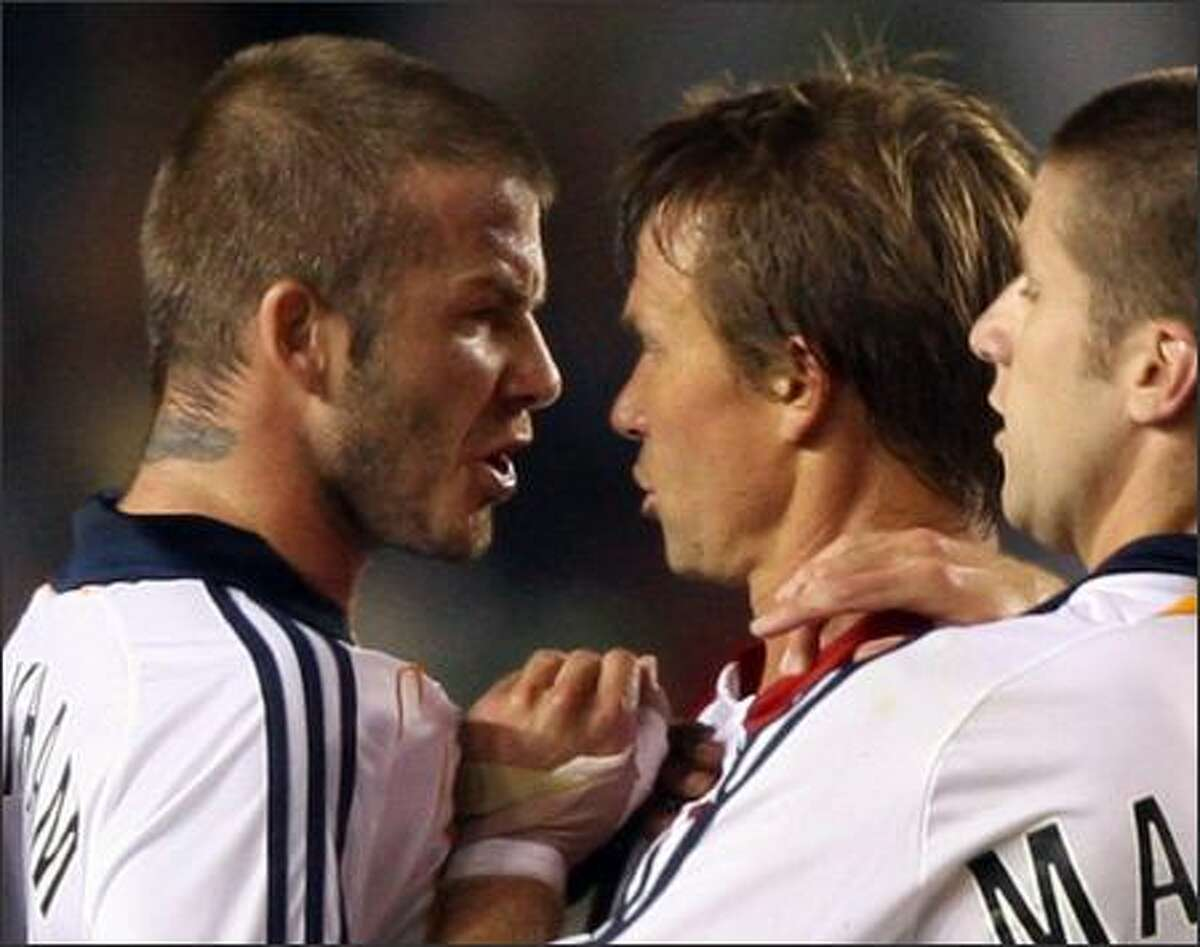 David Beckham (2L) of the Los Angeles Galaxy confronts Chivas USA's Jesse Marsch (2R) after Beckham was tackled by Marsch in first half MLS action, 23 August 2007 at the Home Depot Center in Carson, California. PHOTO/ROBYN BECK/AFP/Getty Images