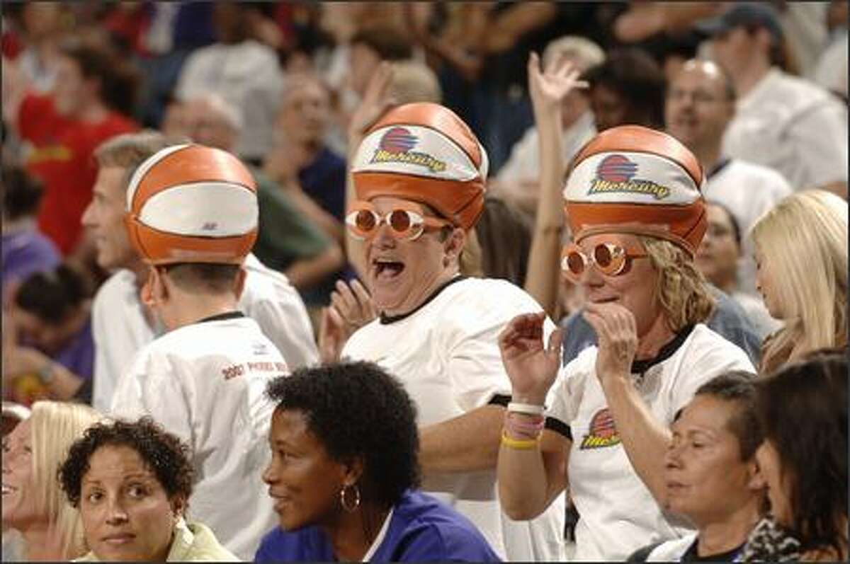 Phoenix Mercury fans watch as the Mercury host the Detroit Shock during Game Three of the WNBA Finals at U.S. Airways Center in Phoenix, Arizona. (Photo by Barry Gossage/NBAE via Getty Images)