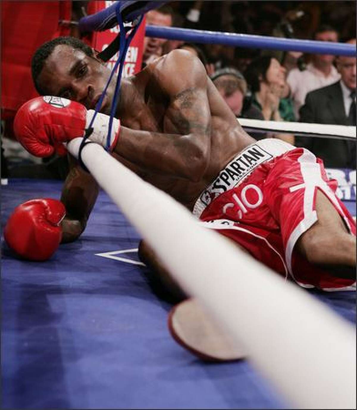 Vivian Harris is knocked out by Junior Witter for the WBC Light Welteweight title at The Doncaster Dome in Doncaster, England. (Photo by John Gichigi/Getty Images)