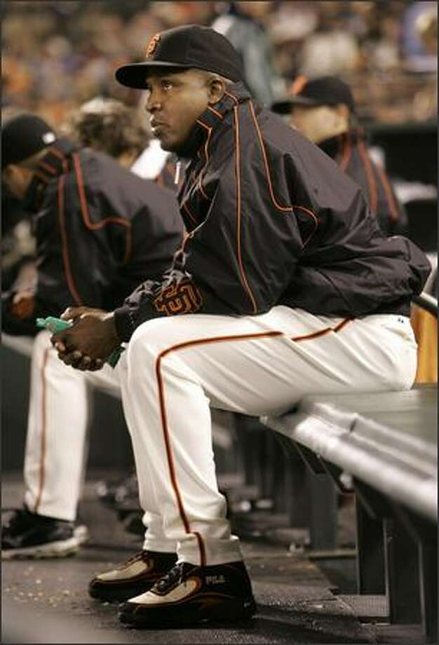 San Francisco Giants' Barry Bonds watches as the Giants play the Cincinnati Reds in the fourth inning in San Francisco, Friday, Sept. 21, 2007. The Reds won 9-8 in 11 innings. The Giants have told Bonds that he won't play for them in 2008. (AP Photo/Jeff Chiu)