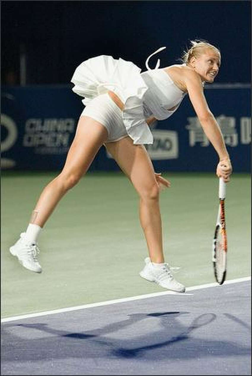 Hungarian Agnes Szavay serves the ball to Chinese Shuai Peng during their semi-final match of the China Open Tennis Tournament in Beijing Saturday, Sept. 22, 2007. Szavay beat Shuai by 6-1, 6-2 and will face Serbian Jelena Jankovic in the final on Sunday. (AP Photo/Andy Wong)