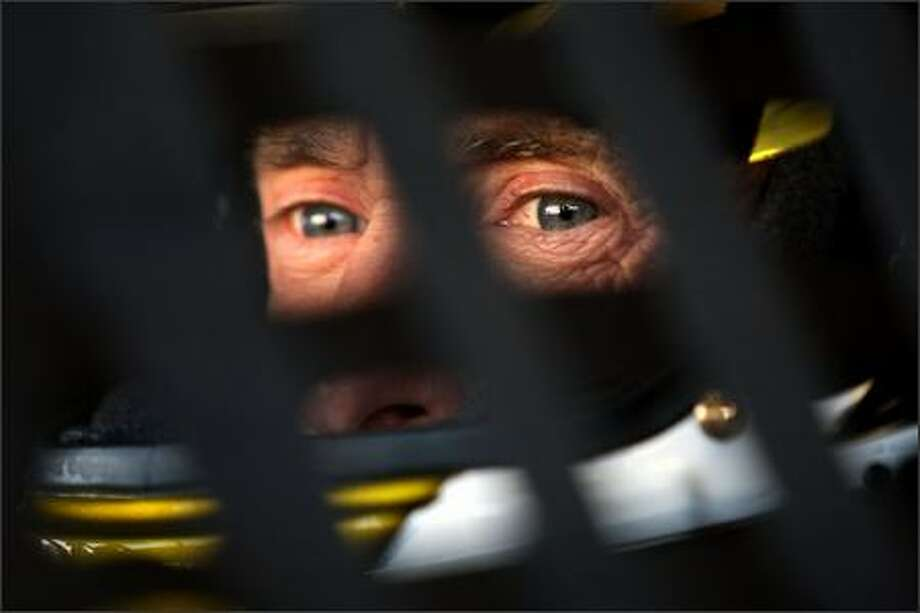Mark Martin, driver of the #01 U.S. Army Chevrolet, sits in his car during practice for the NASCAR Nextel Cup Series LifeLock 400 at Kansas Speedway on September 28, 2007 in Kansas City, Kansas. (Photo by Jamie Squire/Getty Images)
