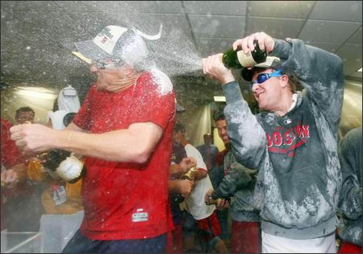 Mike Timlin of the Boston Red Sox and Kurt Schilling #38 celebrate after they defeated the Minnesota Twins 5-2 and the New York Yankees lost to the Baltimore Orioles to allow the Red Sox to clinch the American League East Division Championship on September 28, 2007 at Fenway Park in Boston, Massachusetts. (Photo by Elsa/Getty Images)