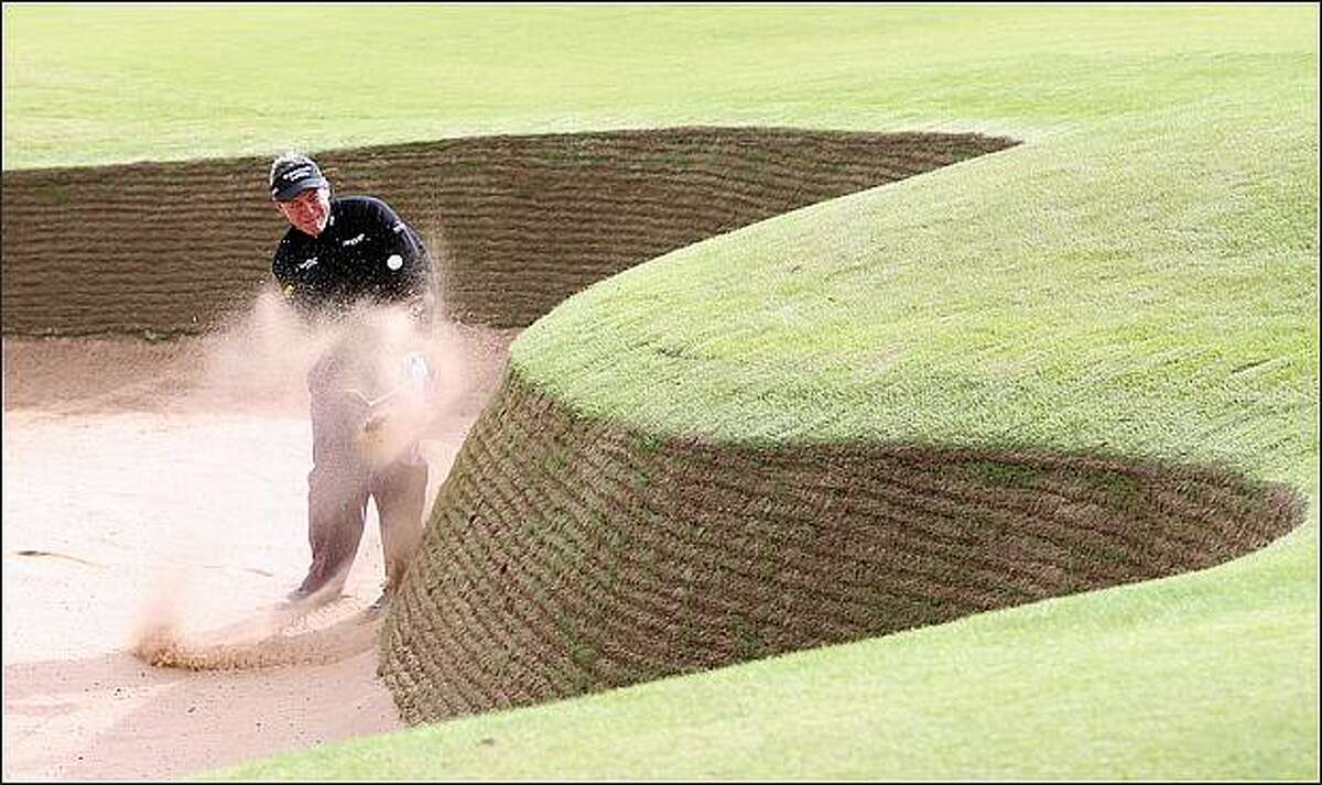 Darren Clarke of Northern Ireland plays out from a bunker on the third hole during the final practice round of The Alfred Dunhill Links Championship at Kingsbarns Golf Links on October 1, 2008 in Kingbarns, Scotland. (Photo by Ross Kinnaird/Getty Images)