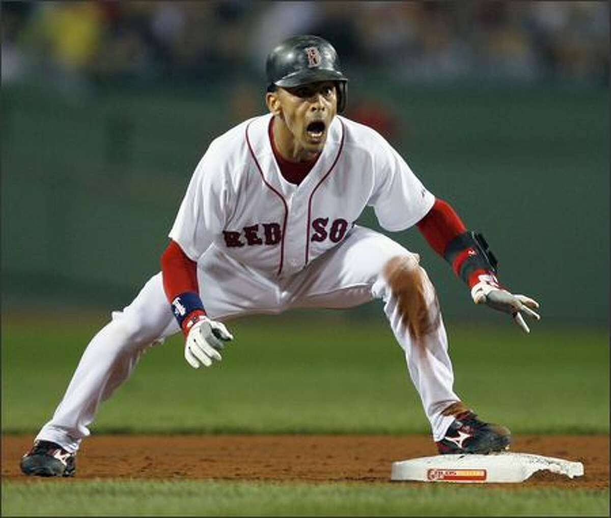 Julio Lugo #23 of the Boston Red Sox reacts after he is called out after stealing second base in the second inning against the Los Angeles Angels during the American League Division Series on October 3, 2007 at Fenway Park in Boston, Massachusetts. (Photo by Jim Rogash/Getty Images)