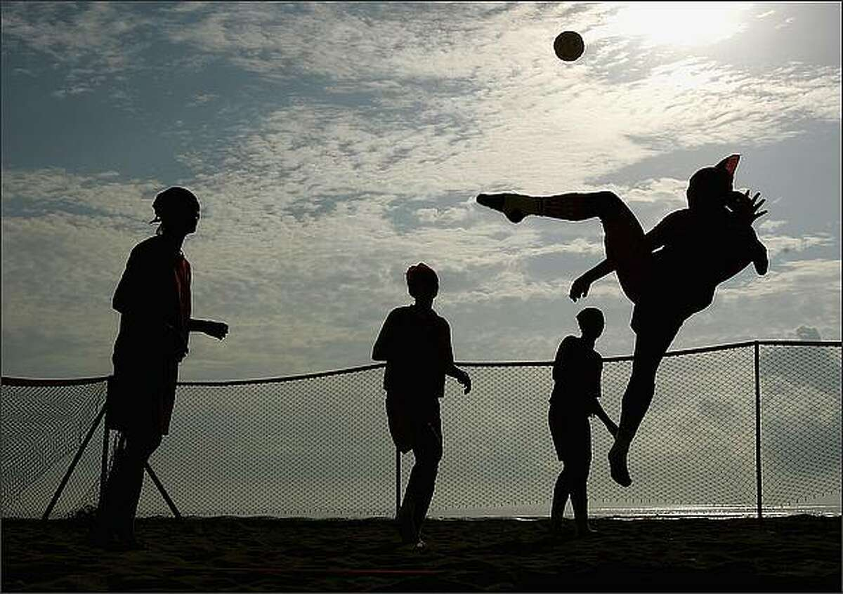 The Vietnamese women's Beach Sepaktakraw team practices before their game on day one of the 2008 Asian Beach Games at Sanur Beach in Bali, Indonesia. (Photo by Ezra Shaw/Getty Images)