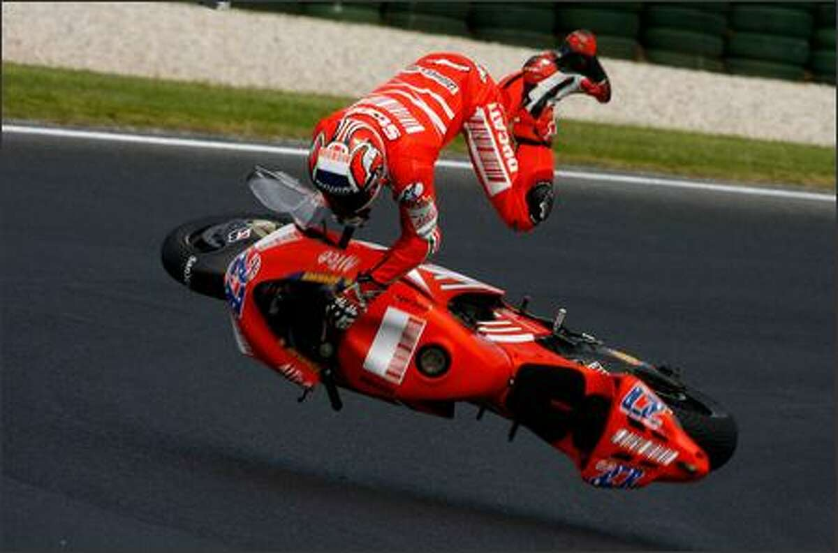 Casey Stoner of Australia and the Ducati Team crashes during free practice for the 2007 Australian Motorcycle Grand Prix at the Phillip Island Circuit in Phillip Island, Australia. (Photo by Andrew Northcott/Getty Images)