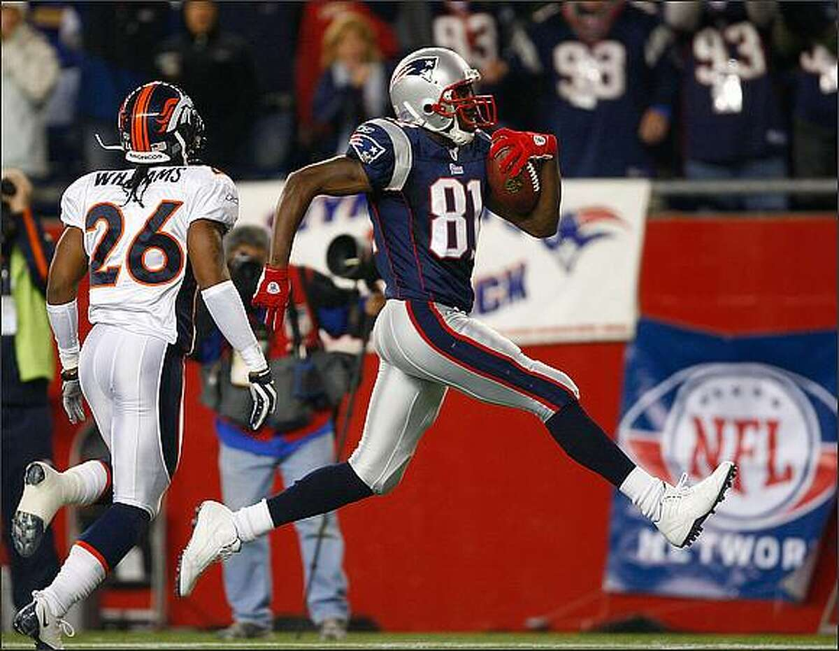 FOXBOJack Williams #26 of the Denver Broncos cannot stop a touchdown by Randy Moss #81 of the New England Patriots at Gillette Stadium in Foxboro, Massachusetts. The Patriots won 41-7. (Photo by Jim Rogash/Getty Images)