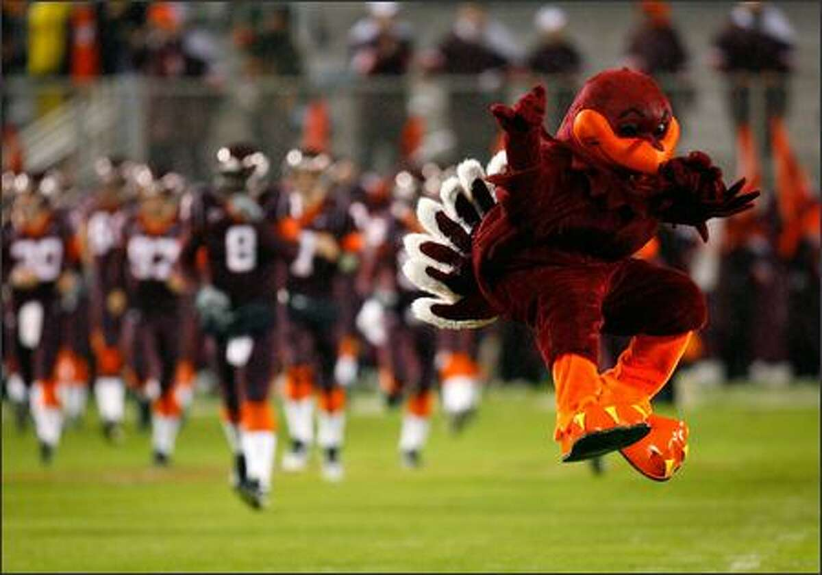 The mascot of the Virginia Tech Hokies leads the team onto the field to face the Boston College Eagles at Lane Stadium in Blacksburg, Virginia. (Photo by Kevin C. Cox/Getty Images)