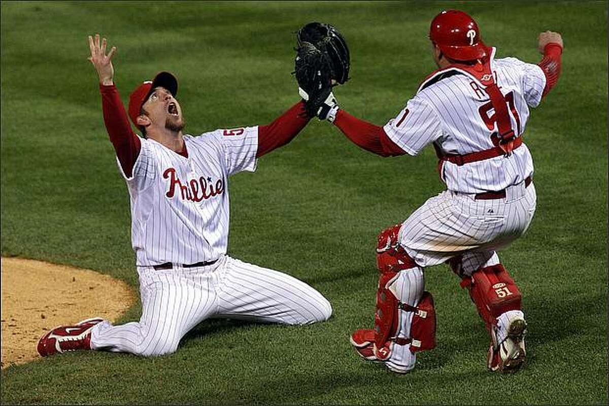 Brad Lidge #54 (L) and Carlos Ruiz #51 of the Philadelphia Phillies celebrate the final out of their 4-3 win to win the World Series against the Tampa Bay Rays during the continuation of game five of the 2008 MLB World Series at Citizens Bank Park in Philadelphia, Pennsylvania. (Photo by Jim McIsaac/Getty Images)