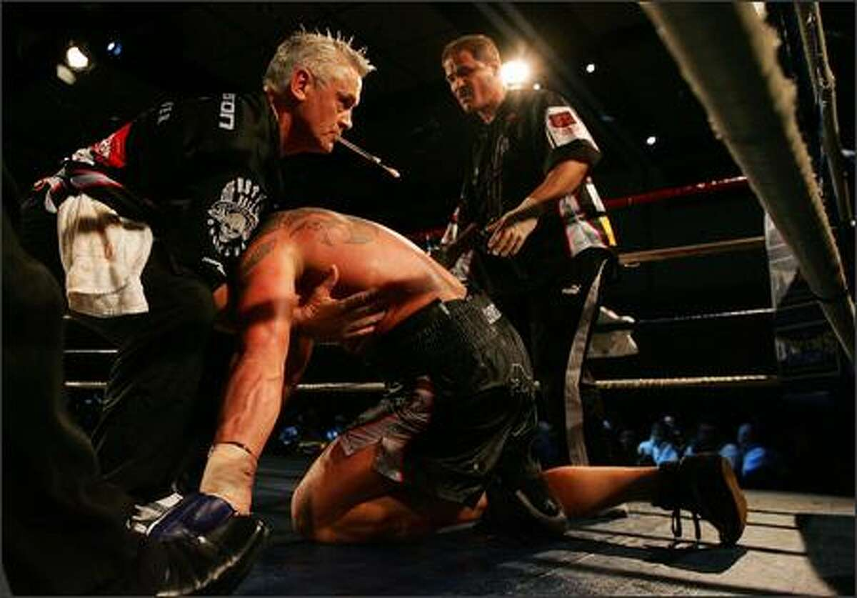 Shane Cameron of New Zealand crawls back to his feet after being knocked out by Friday Ahunanya of the USA during the WBO Asia Pacific Title Fight at the SKYCITY Convention Centre in Auckland, New Zealand. Photo by Hannah Johnston/Getty Images