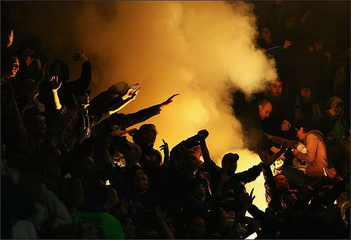 A flare is lit during the UEFA Cup Group D match between Tottenham Hotspur and Dinamo Zagreb at White Hart Lane in London, England. (Photo by Clive Rose/Getty Images)