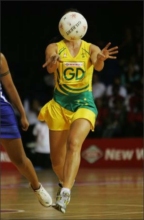 Mo'onia Gerrard of Australia passes the ball during the 2007 Netball World Championship pool B match between Australia and Samoa at the Trusts Stadium in Auckland, New Zealand. (Photo by Sandra Mu/Getty Images)