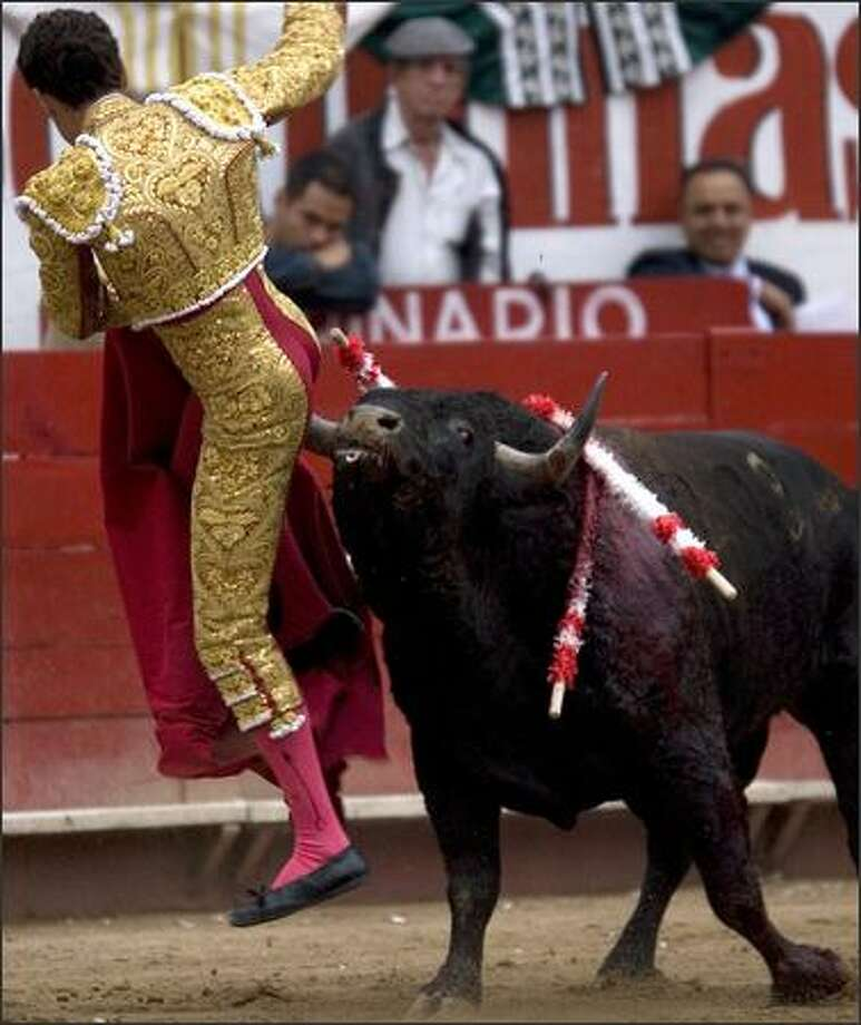 Spanish bullfighter Jose Tomas is butted by the bull during a bullfight in Guadalajara, Mexico. (AP Photo/Guillermo Arias)