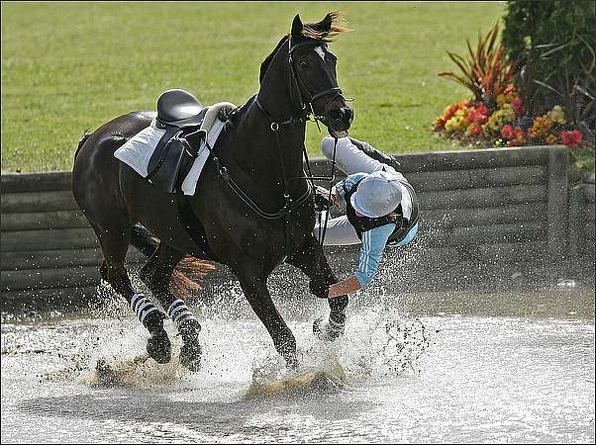 Natalie Sharples comes off her horse Jungle at the water jump during the cross country at the Manukau City Puhinui three day horse trials in Auckland, New Zealand, (Photo by Chris Skelton/Getty Images)
