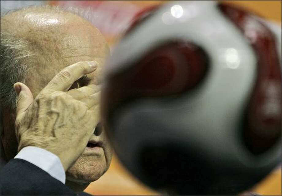 FIFA President Sepp Blatter rubs his eye as he speaks at a press conference at the ICC in Durban, South Africa. The preliminary draw for the 2010 soccer World Cup is scheduled to take place in Durban later on Sunday. (AP Photo/Tsvangirayi Mukwazhi)