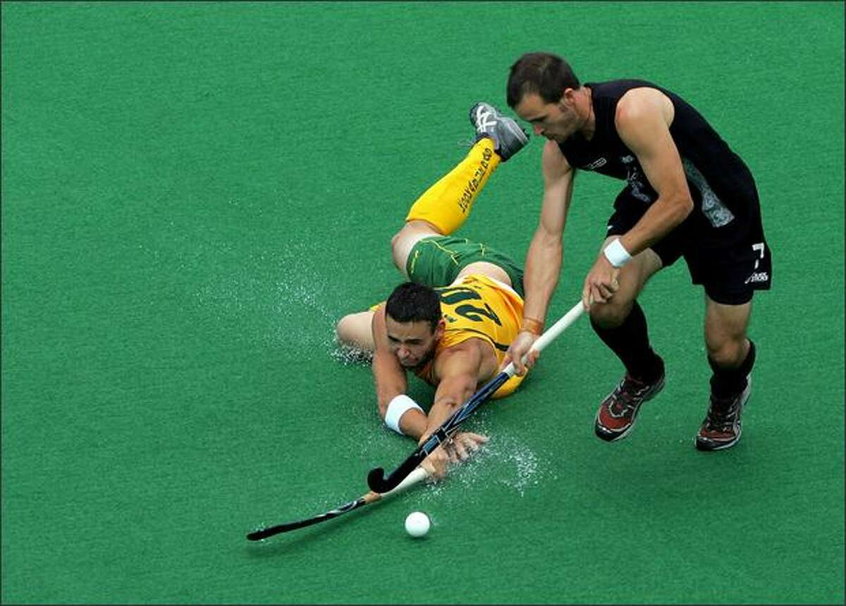 Matthew Naylor of Australia dives to try to steal the ball from Blair Hopping of New Zealand during the third test match between the Australian Kookaburras and the New Zealand Black Sticks at the Sydney Olympic Park in Sydney, Australia. (Photo by Ezra Shaw/Getty Images)