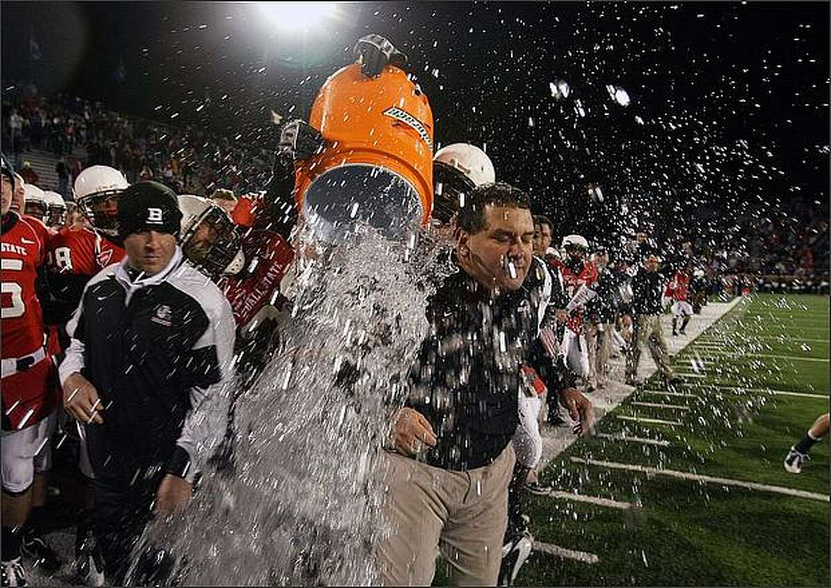 Head coach Brady Hoke of the Ball State Cardinals is splashed with water in the final seconds of the Mid-American Conference (MAC) game against the Western Michigan Broncos at Scheumann Stadium in Muncie, Indiana. Ball State won 45-22 and finished their regular season at 12-0. (Photo by Andy Lyons/Getty Images)