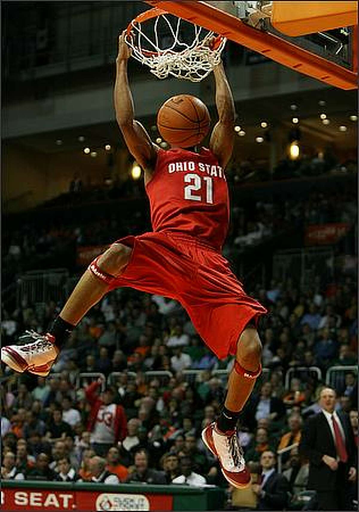Evan Turner of the Ohio State Buckeyes gets a breakaway dunk while taking on the Miami Hurricanes at BankUnited Center in Coral Gables, Florida. Ohio State defeated Miami 73-68. (Photo by Doug Benc/Getty Images)