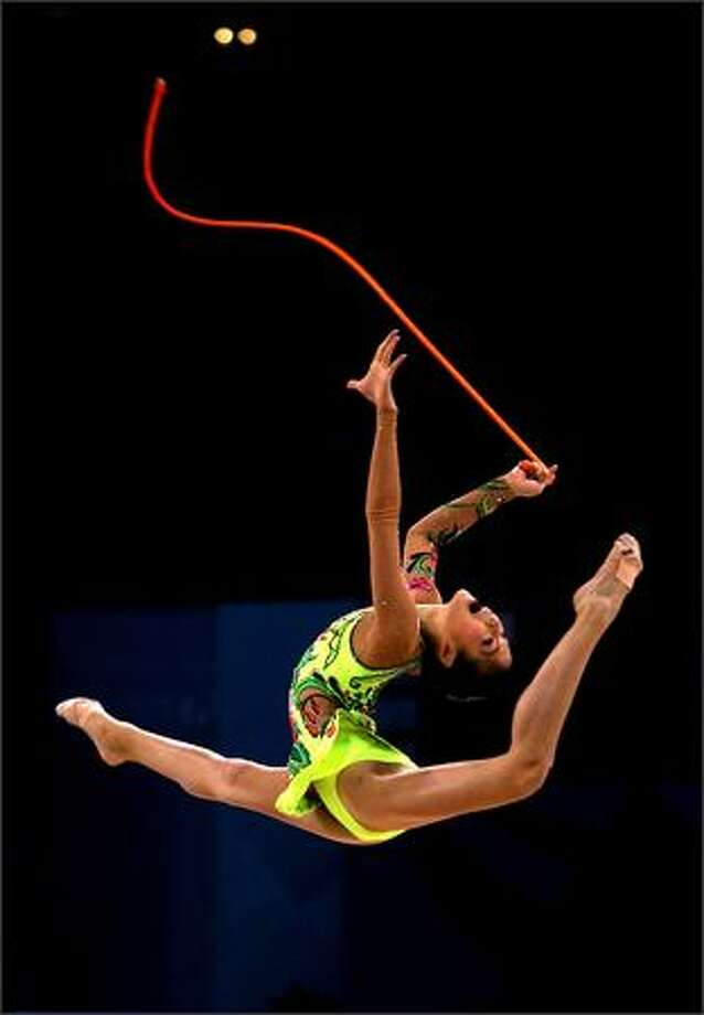 "Shin Soo Ji of South Korea performs with the rope during the qualification competition of the ""Good Luck Beijing"" Rhythmic Gymnastics International Invitational Tournament, part of the 2008 Olympics test events, at the Beijing University of Technology Gymnasium in Beijing, China. (Photo by China Photos/Getty Images)"