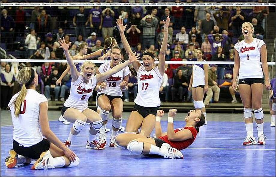 Nebraska's, left to right, Jordan Larson, Rachel Schwartz, Tara Mueller, Amanda Gates, Kayla Banworth and Sydney Anderson celebrate as Nebraska defeats Washington in the 5th game during the NCAA Div. 1 regional women's volleyball in Seattle. (AP Photo/Kevin P. Casey)