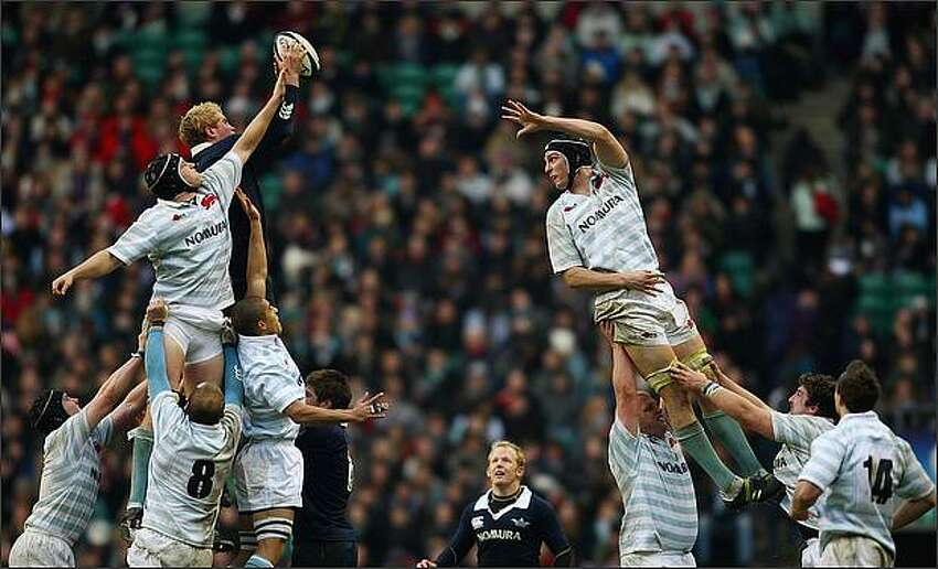 Ian Kench of Oxford jumps in the line out with Martin Wilson and Daniel Vickerman of Cambridge during the Varsity Rugby Match between Oxford University and Cambridge University at Twickenham in Twickenham, England. (Photo by Jamie McDonald/Getty Images)