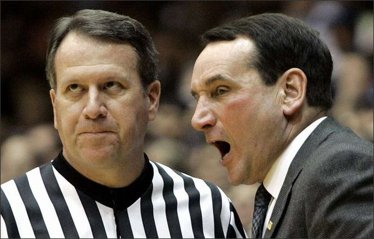 Duke coach Mike Krzyzewski, right, argues with an official during the second half of a college basketball game against Albany in Durham, N.C., Monday, Dec. 17, 2007. Duke won 111-70. (AP Photo/Gerry Broome)