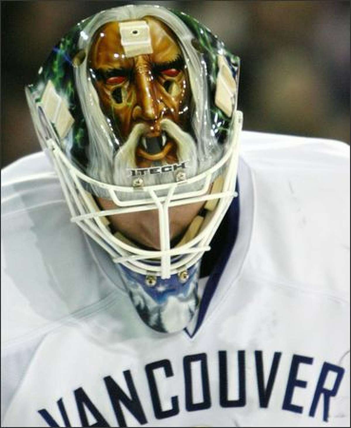 Vancouver Canucks' Curtis Sanford skates to the corner during a break in play against the Edmonton Oilers during second period NHL hockey action in Edmonton on Saturday, Dec. 15, 2007. (AP Photo/The Canadian Press via The Edmonton Sun, Darryl Dyck)