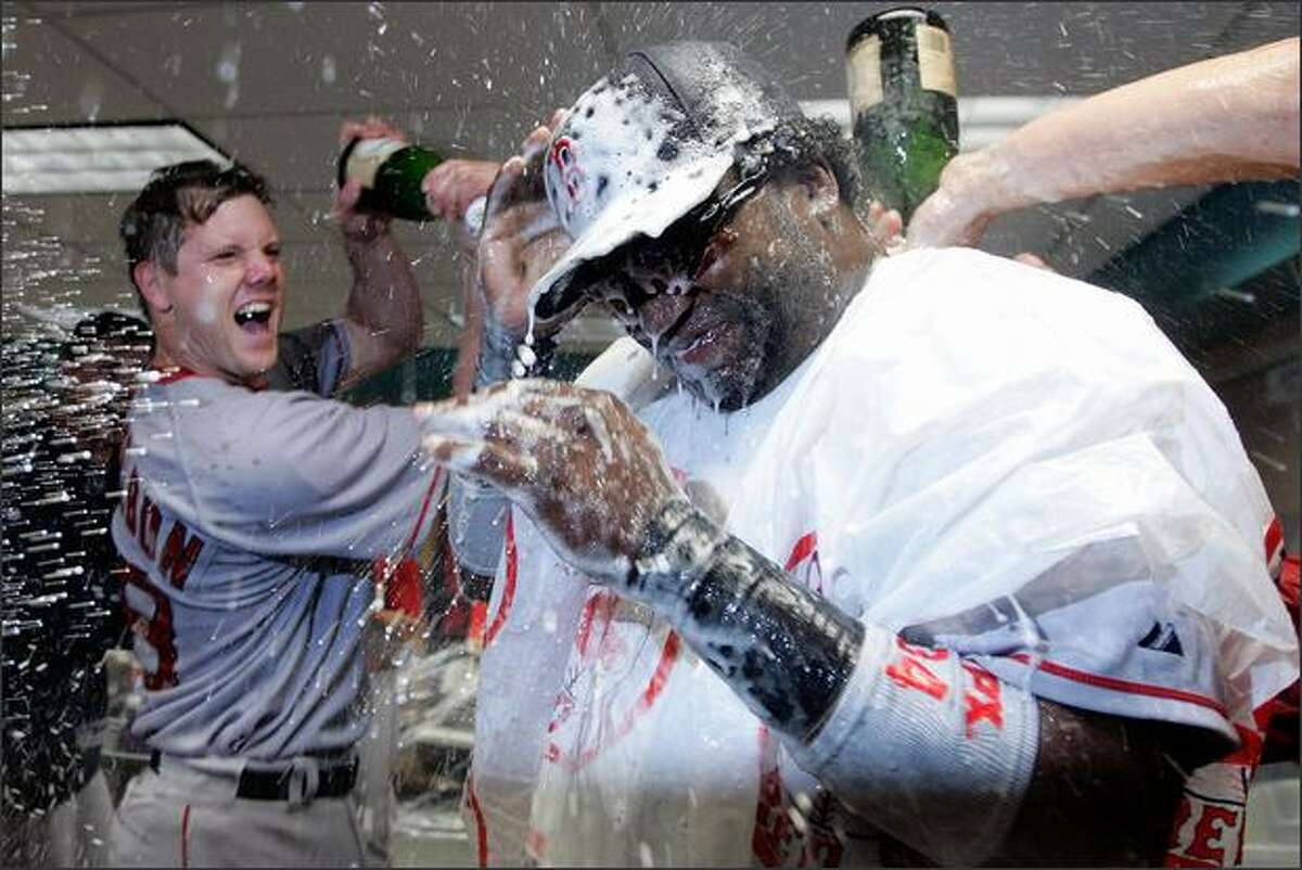 Jonathan Papelbon #58 of the Boston Red Sox pours champagne on David Ortiz #34 after the Red Sox defeated the Los Angeles Angels of Anaheim 9-1 and sweept the Angels to advance to the American League Championship Series during Game Three of the American League Divisional Series at Angel Stadium in Anaheim, California. Photo by Jeff Gross/Getty Images