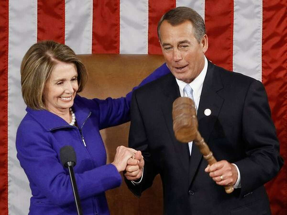 WASHINGTON, DC - Speaker of the House John Boehner (R-OH) (R) receives the Speaker's gavel from outgoing Speaker of the House Nancy Pelosi (D-CA) (L) Wednesday in Washington, DC. The 112th U.S. Congress will be sworn-in today, with Republican legislators taking control of the House of Representatives and expected to begin attempts to dismantle portions of U.S. President Barack Obamas legislative agenda. (Photo by Chip Somodevilla/Getty Images)