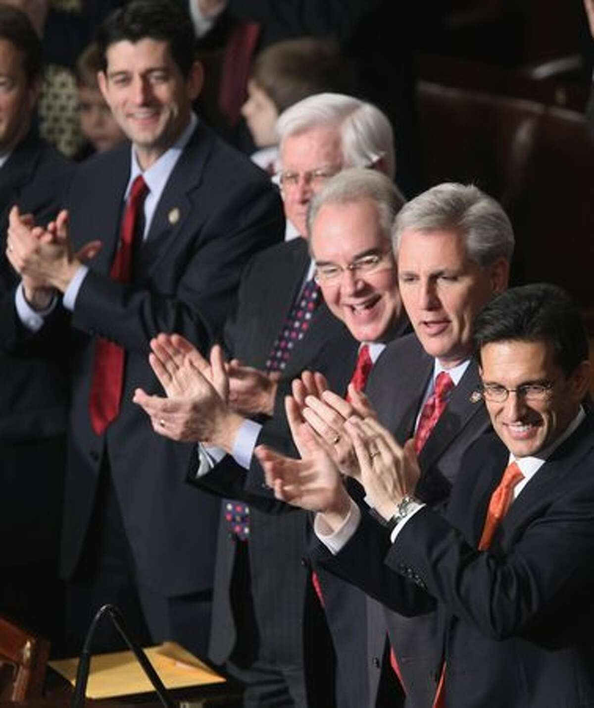 WASHINGTON, DC - House Majority Leader-designate Rep. Eric Cantor (R-VA) (R) and majority whip-designate Rep. Kevin McCarthy (R-CA) (2nd R) applaud during roll call votes on the election of the next Speaker of the House Wednesday in Washington, DC. The 112th U.S. Congress will be sworn-in today, with Republican legislators taking control of the House of Representatives and expected to begin attempts to dismantle portions of U.S. President Barack Obama's legislative agenda. (Photo by Alex Wong/Getty Images)