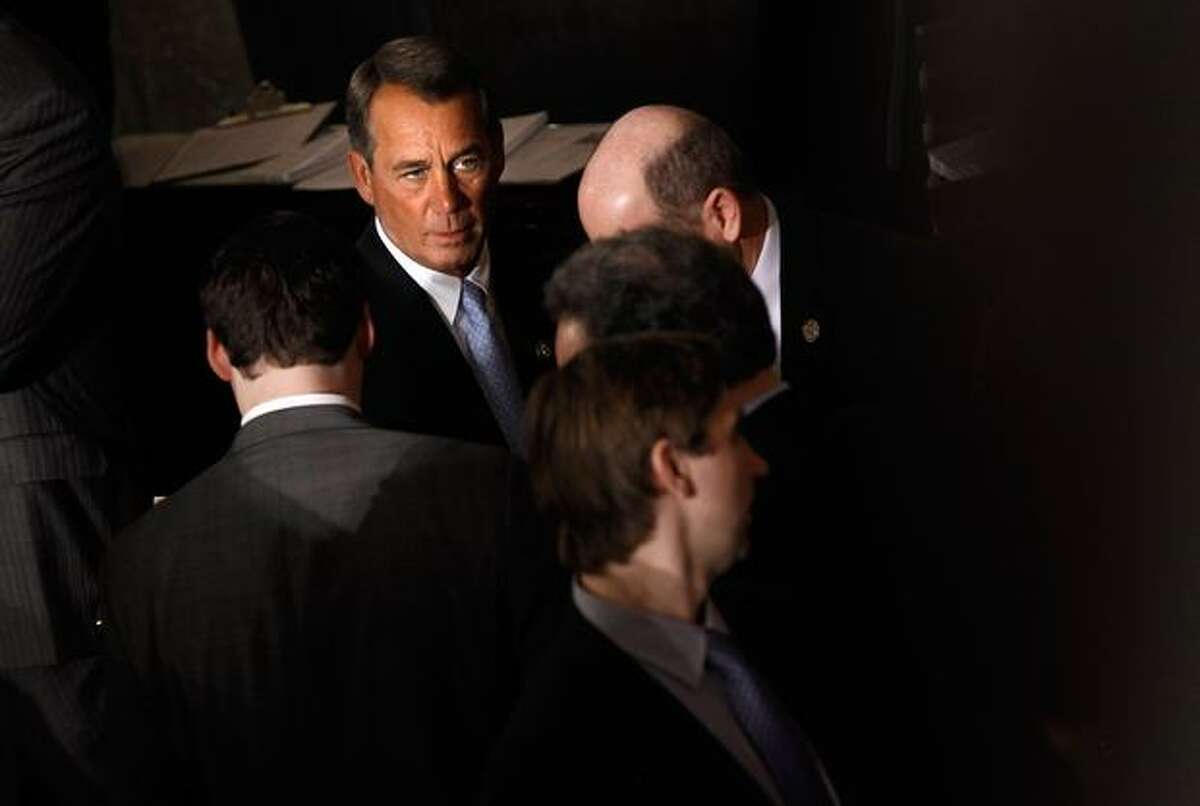 WASHINGTON, DC - Speaker of the House-designate Rep. John Boehner (R-OH) talks with colleagues on the House floor during roll call votes on the election of the next Speaker Wednesday in Washington, DC. The 112th U.S. Congress will be sworn-in today, with Republican legislators taking control of the House of Representatives and expected to begin attempts to dismantle portions of U.S. President Barack Obama's legislative agenda. (Photo by Chip Somodevilla/Getty Images)