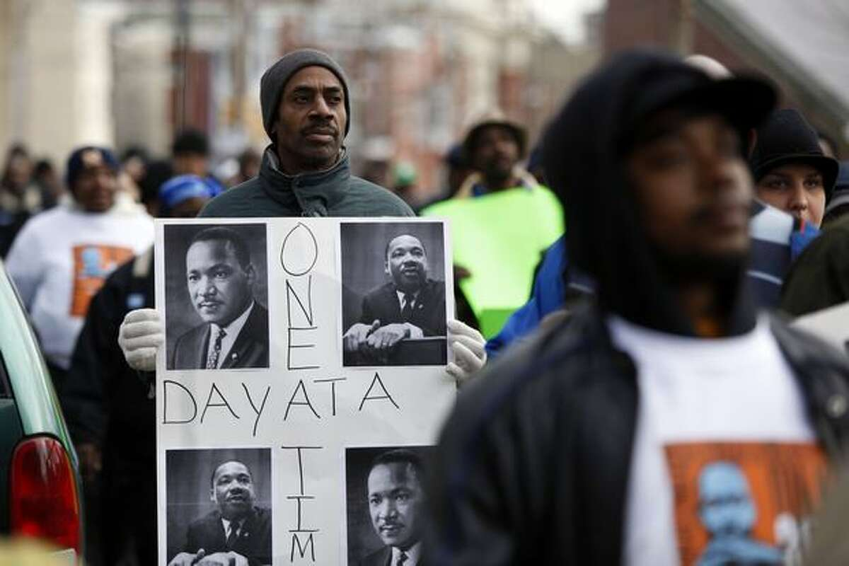 Tyrone Austin marches along with others to take part in the Greater Philadelphia Martin Luther King Day of Service, at Girard College in Philadelphia on Monday. (AP Photo/Matt Rourke)