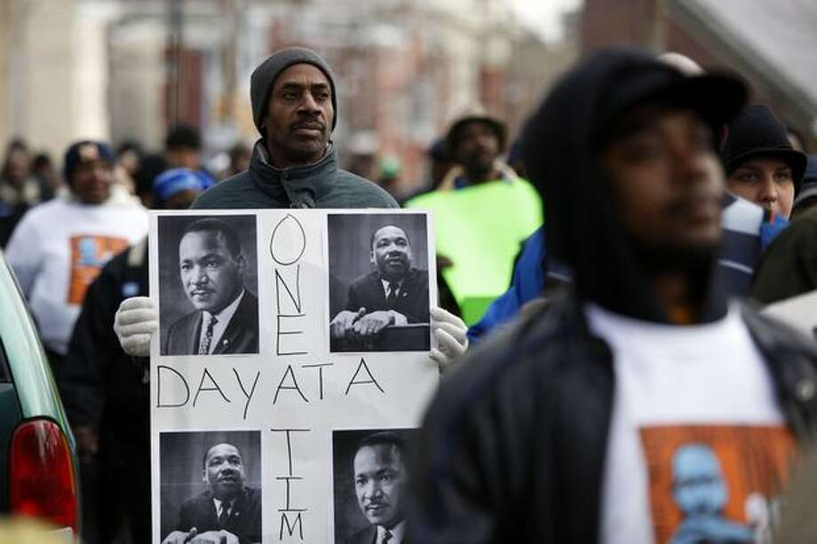 Tyrone Austin marches along with others to take part in the Greater Philadelphia Martin Luther King Day of Service, at Girard College in Philadelphia on Monday. (AP Photo/Matt Rourke) Photo: Associated Press / Associated Press
