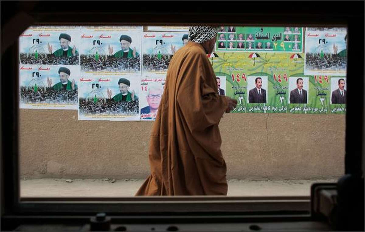 An Iraqi man passes by campaign posters from a Humvee window on January 20, 2009 in Mussayeb, Iraq. Though violence has eased in this formerly war-torn province, soldiers continue to diligently patrol, fearing a dismantling of the fragile peace between area Sunni and Shia Muslims. Iraq is preparing for upcoming provincial elections to choose over 400 seats for members of ruling councils in 14 of the 18 provinces on January 31, 2009.