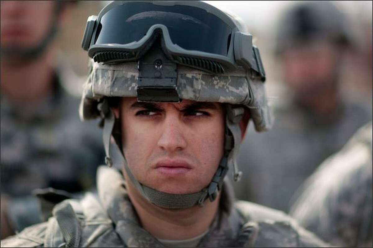 A soldier with the US Army's 172nd Infantry Brigade listens to a briefing on January 20, 2009 at Forward Operating Base Kalsu, south of Baghdad, Iraq. Though violence has eased in some formerly war-torn provinces, soldiers continue to diligently patrol, fearing a dismantling of the fragile peace between area Sunni and Shia Muslims. Iraq is preparing for upcoming provincial elections to choose over 400 seats for members of ruling councils in 14 of the 18 provinces on January 31, 2009.