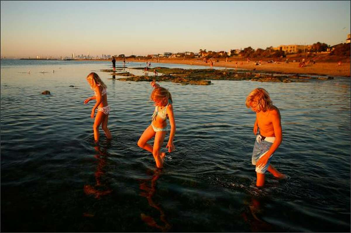Children go for a swim on Brighton Beach as a heatwave hits Melbourne on Tuesday in Melbourne, Australia. The temperature today is estimated to hit 38 degrees celsius or around 100 degrees fahrenheit, with today being the coolest day forecast until next week. Melbourne hasn't had four consecutive days above 40 degrees celsius or 104 degrees fahrenheit since 1908.