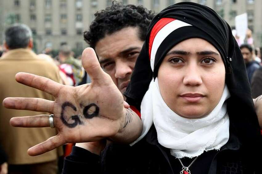 An engaged Egyptian couple join thousands of others as they gather in Cairo's Tahrir Square on Tuesday heeding a call by the opposition for a