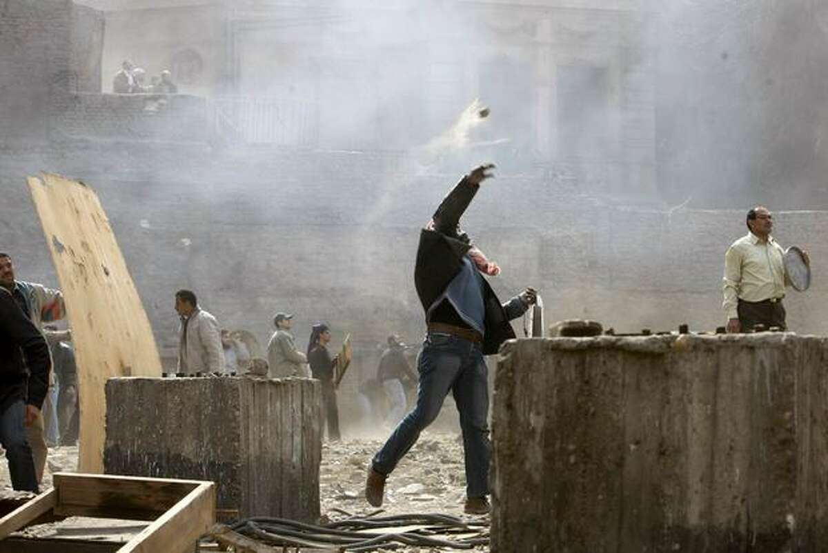 Egyptian anti-government demonstrators battle pro-government opponents in Cairo's Tahrir Square on Thursday on the 10th day of protests calling for the ouster of embattled President Hosni Mubarak.