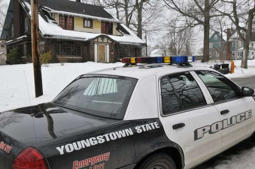A Youngstown State Police University officer patrols the street near the location of an early morning shooting at a fraternity house just north of the Youngstown State University campus that left student Jamail E. Johnson, 25 of Youngstown dead and 11 injured Sunday, in Youngstown, Ohio. (AP Photo/Mark Stahl)