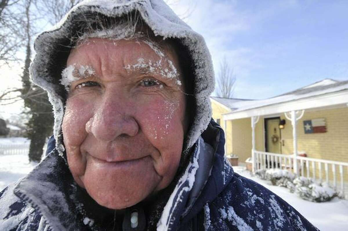 Don Martin is covered in snow after clearing it from his yard in Amarillo, Texas, n Wednesday after an overnight snow storm dumped more the 8-inches of snow on the Texas Panhandle. (AP Photo/Amarillo Globe-News, Michael Schumacher)