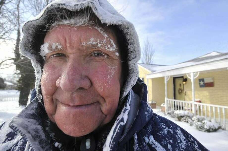 Don Martin is covered in snow after clearing it from his yard in Amarillo, Texas, n Wednesday after an overnight snow storm dumped more the 8-inches of snow on the Texas Panhandle. (AP Photo/Amarillo Globe-News, Michael Schumacher) Photo: Odd Andersen, AFP / Getty Images / AFP / Getty Images