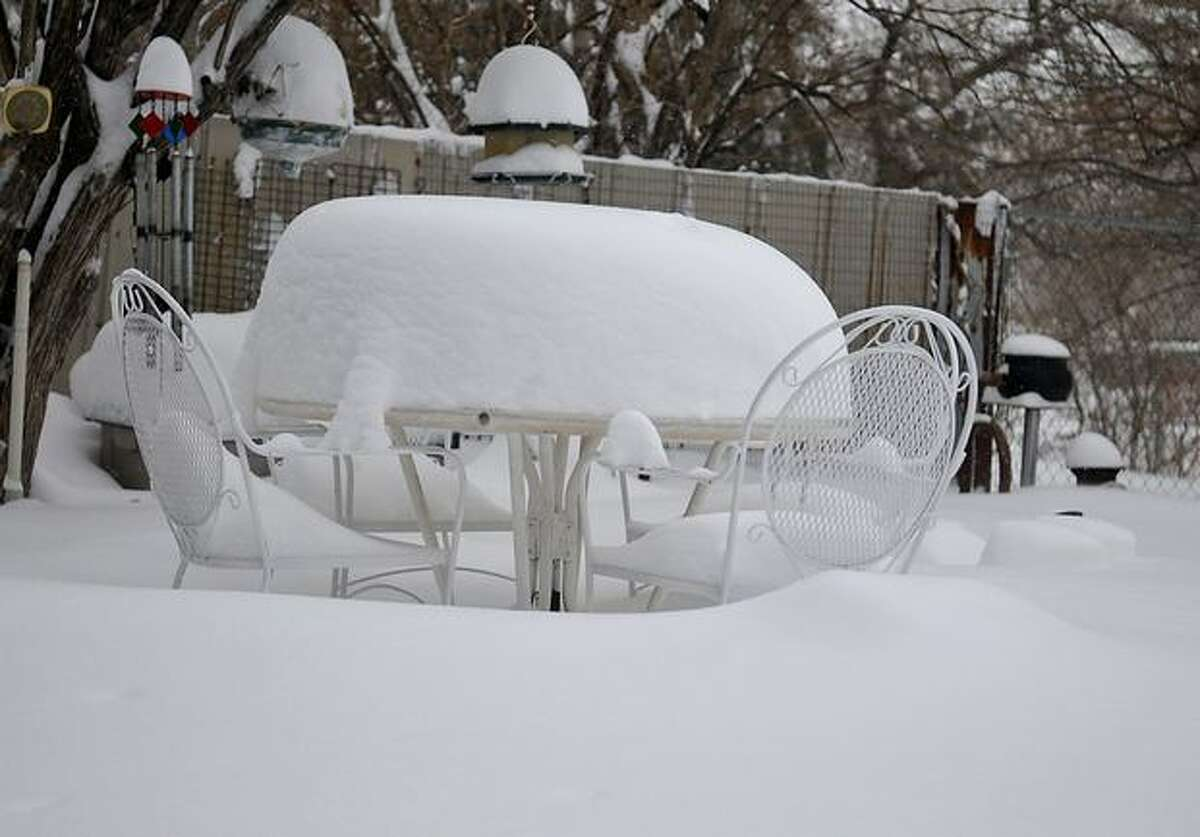 Snow covers a patio table Wednesday in Enid, Okla., after a winter storm dropped an estimated foot of snow on north central Oklahoma. (AP Photo/Enid News & Eagle, Billy Hefton)