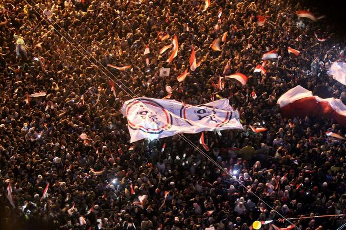 Egyptian anti-government demonstrators celebrate at Cairo's Tahrir Square after President Hosni Mubarak stepped down on Friday.