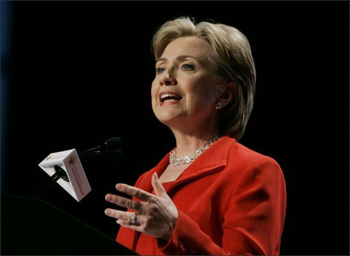 Democratic presidential hopeful, Sen. Hillary Rodham Clinton, D-N.Y., makes a campaign stop at the Greater Houston Partnership Conference at the George R. Brown Convention Center in Houston, Thursday. (AP Photo/Carolyn Kaster)