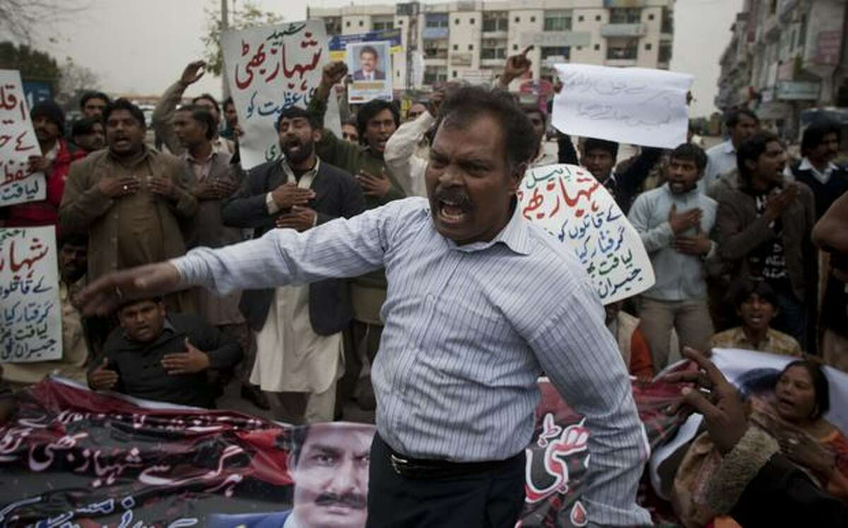 Pakistani Christians rally to protest the killing of their leader and government's minister for minorities Shahbaz Bhatti, outside his home in Islamabad, Pakistan, on Thursday. Hundreds of Christians and others demonstrated against the slaying of a Catholic government minister, demanding justice. (AP Photo/B.K.Bangash)