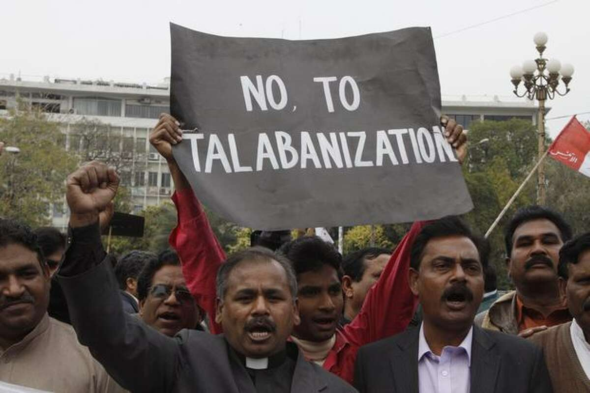 Pakistani Christians rally against the killing of a Catholic government minister Shahbaz Bhatti, in Lahore, Pakistan, on Thursday. Hundreds of Pakistani Christians and others demonstrated demanding justice to nab killers of Bhatti. (AP Photo/K.M.Chaudary)