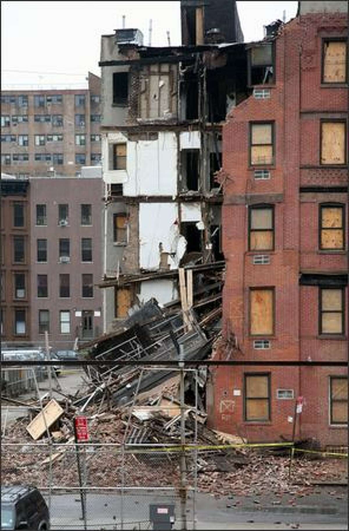 A vacant building on 124 St. and Park Ave. is seen after collapsing in Harlem, New York, Tuesday. The five-story vacant apartment building partially collapsed, leading to the suspension of dozens of rush-hour suburban trains. There were no immediate reports of injuries.