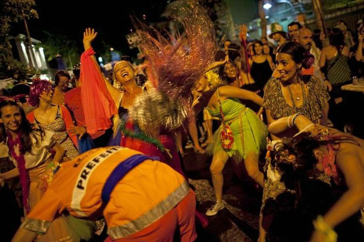 Revelers perform during the 'Mameludicos Euforicos' street carnival parade in Rio de Janeiro, Brazil, on Thursday. (AP Photo/Rodrigo Abd)
